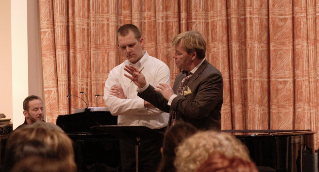 Noel Edison gives Symposium participant Adam Kluck some assistance at the 2015 Symposium