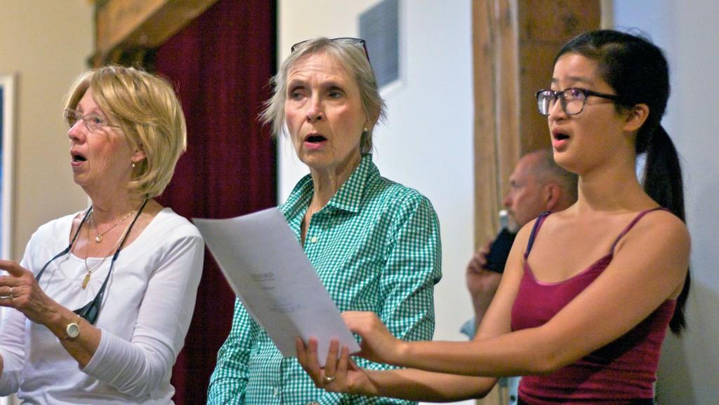 Three women singing at Singsation 2015