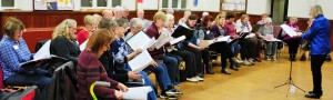 Janice Schulyer Ketchen conducts the Lynn Valley Voices in rehearsal