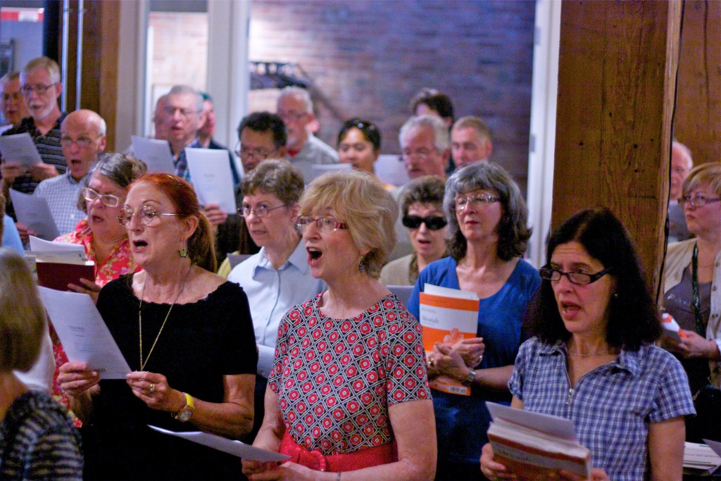 Singers at Singsation Saturday, reading from Messiah scores.