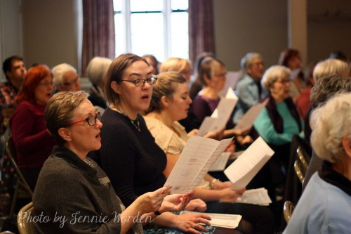Rows of singers reading music.