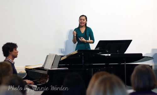 Elaine Cho conducting with Michel Ross at the piano in Cameron Hall.