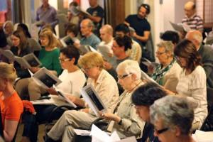 Singers sight-reading sheet music.