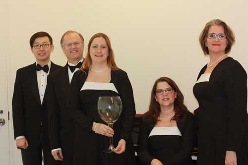 Five choristers and a giant wineglass